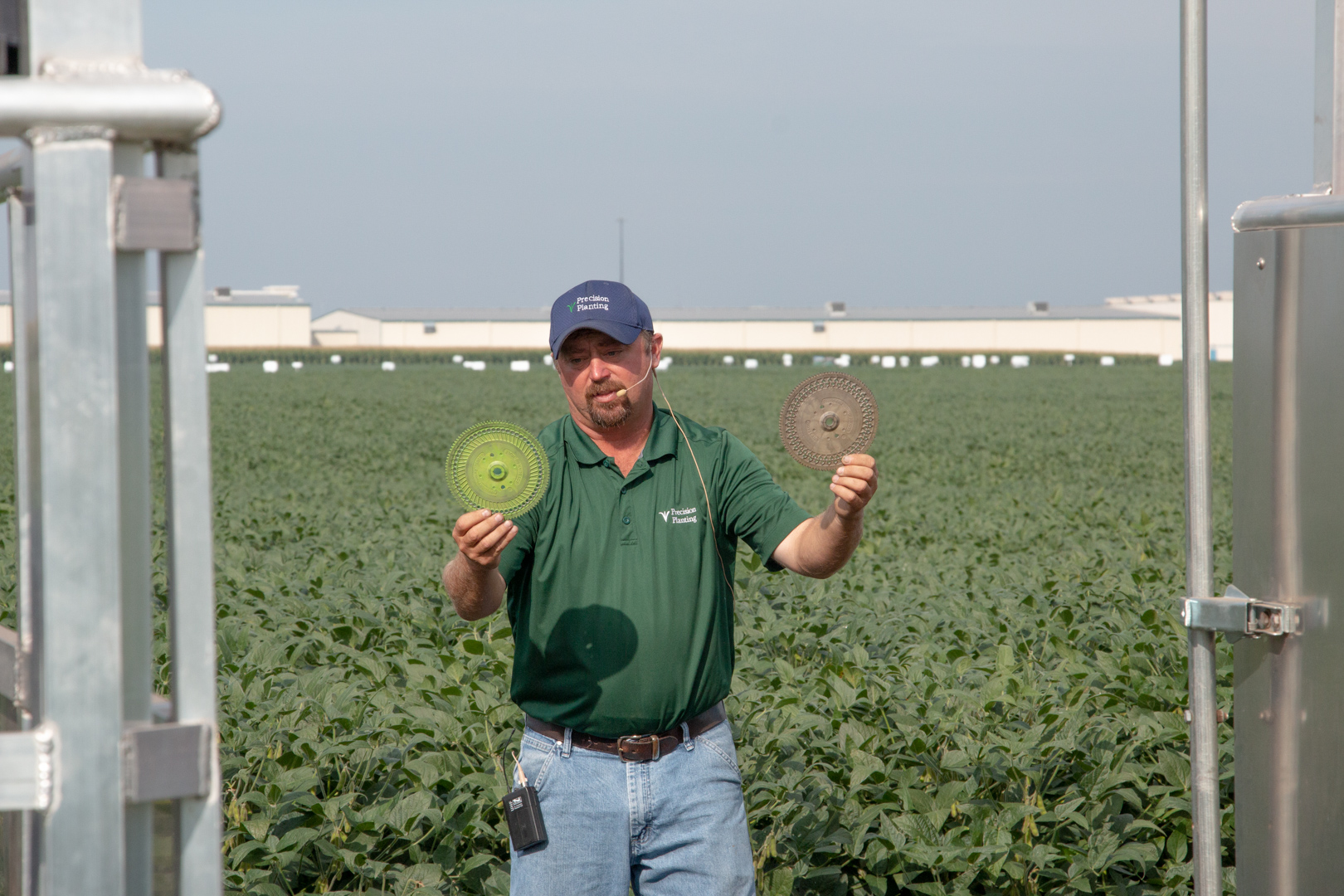 Agronomist with seed disks on the agronomy tour at the PTI Farm.